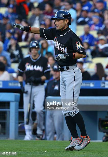 Ichiro Suzuki of the Miami Marlins looks on after scoring in the seventh inning during the MLB game against the Los Angeles Dodgers at Dodger Stadium...