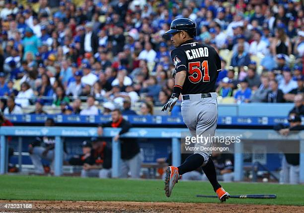 Ichiro Suzuki of the Miami Marlins looks on after scoring on a twoRBI single to center by teammate Giancarlo Stanton in the seventh inning during the...