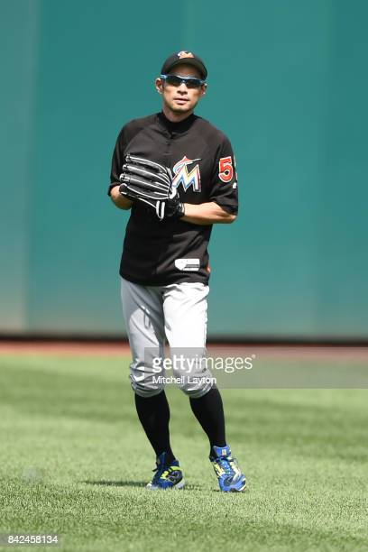 Ichiro Suzuki of the Miami Marlins looks on during batting practice of a baseball game against the Washington Nationals at Nationals Park on August...