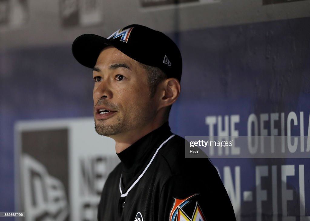 Ichiro Suzuki #51 of the Miami Marlins looks on from the dugout before the game against the New York Mets on August 18, 2017 at Citi Field in the Flushing neighborhood of the Queens borough of New York City.