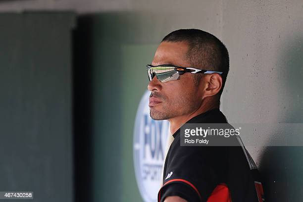 Ichiro Suzuki of the Miami Marlins looks on from the dugout during the sixth inning of the game against the Boston Red Sox at Roger Dean Stadium on...