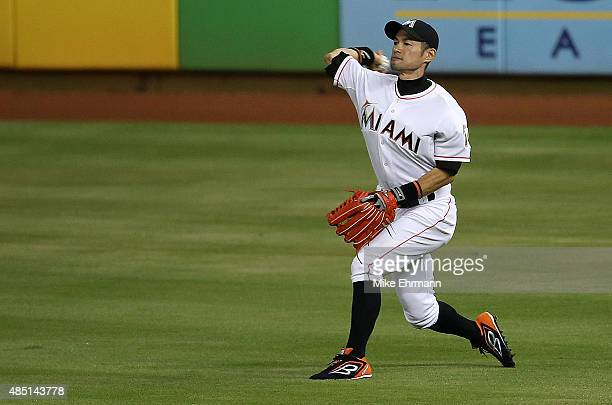 Ichiro Suzuki of the Miami Marlins makes a throw to second during a game against the Pittsburgh Pirates at Marlins Park on August 24 2015 in Miami...