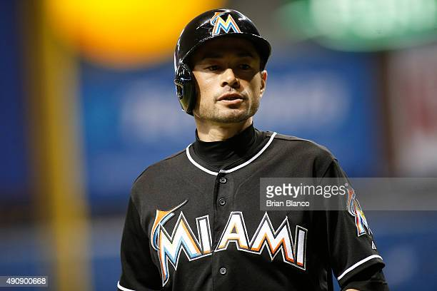 Ichiro Suzuki of the Miami Marlins makes his way to the dugout after hitting a sacrifice fly to left field to score Marcell Ozuna during the fifth...