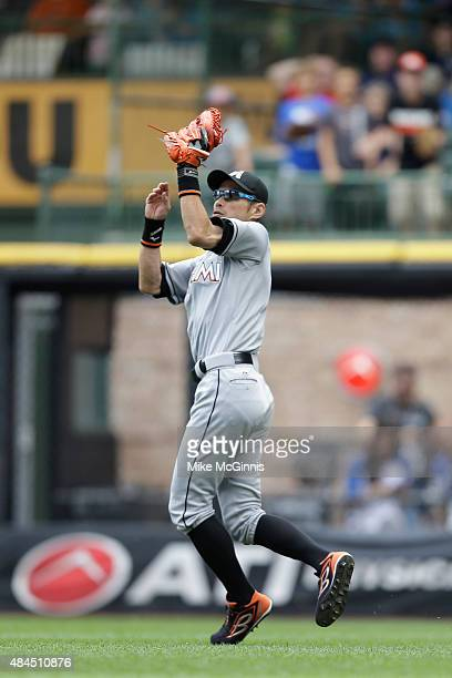 Ichiro Suzuki of the Miami Marlins makes the catch in right field to retire Hernan Perez of the Milwaukee Brewers during the seventh inning at Miller...