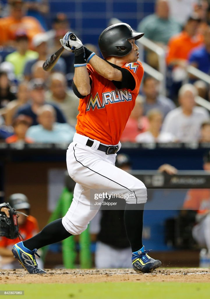 Ichiro Suzuki #51 of the Miami Marlins pinch hitting before grounding out in the eighth inning in front of Jorge Alfaro #38 of the Philadelphia Phillies at Marlins Park on September 3, 2017 in Miami, Florida.