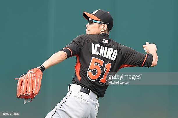 Ichiro Suzuki of the Miami Marlins plays catch during batting practice of a baseball game against the Washington Nationals at Nationals Park on...