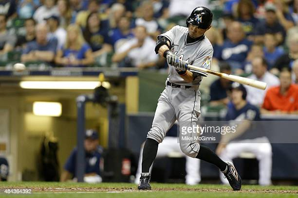 Ichiro Suzuki of the Miami Marlins pops up to centerfield during the third inning against the Milwaukee Brewers at Miller Park on August 17 2015 in...