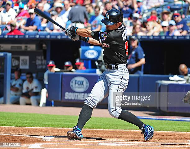 Ichiro Suzuki of the Miami Marlins reaches first base on a first inning error by the Atlanta Braves at Turner Field on May 28 2016 in Atlanta Georgia...
