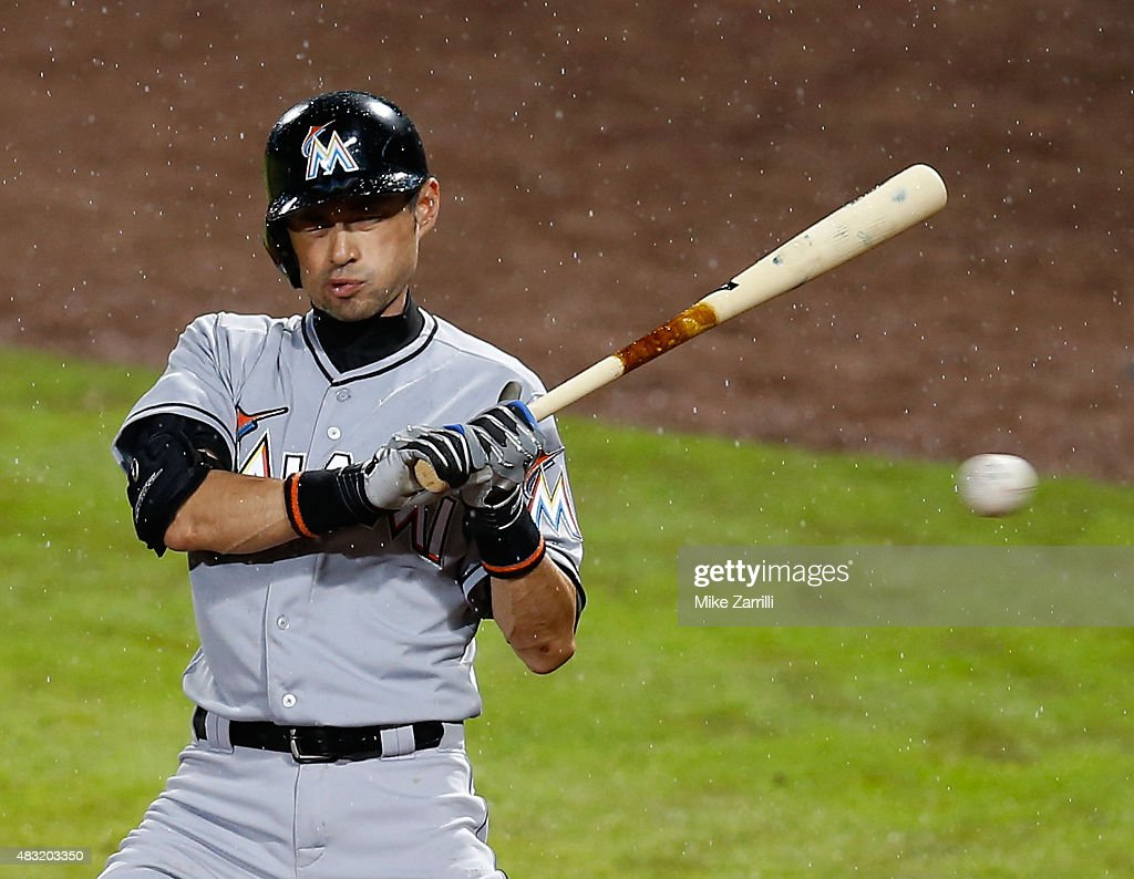 Ichiro Suzuki #51 of the Miami Marlins reacts after an inside pitch in the eighth inning during the game against the Atlanta Braves at Turner Field on August 6, 2015 in Atlanta, Georgia.