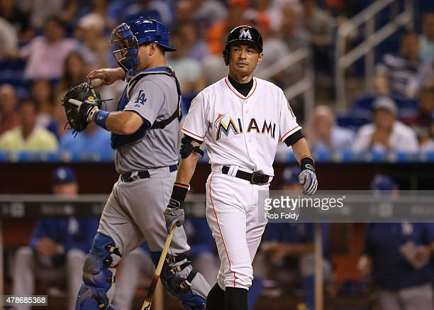 Ichiro Suzuki of the Miami Marlins reacts after striking out swinging during the eighth inning of the game against the Los Angeles Dodgers at Marlins...