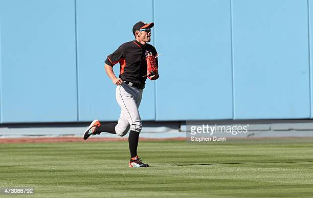 Ichiro Suzuki of the Miami Marlins runs in the outfield during batting practice for the game with the Los Angeles Dodgers at Dodger Stadium on May 12...