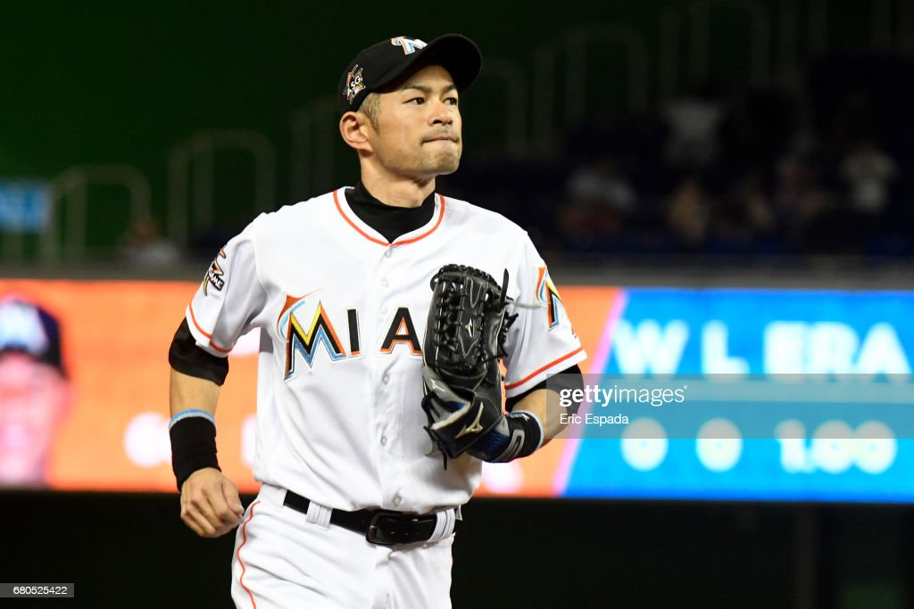 Ichiro Suzuki #51 of the Miami Marlins runs into the dugout during the ninth inning against the St. Louis Cardinals at Marlins Park on May 8, 2017 in Miami, Florida.