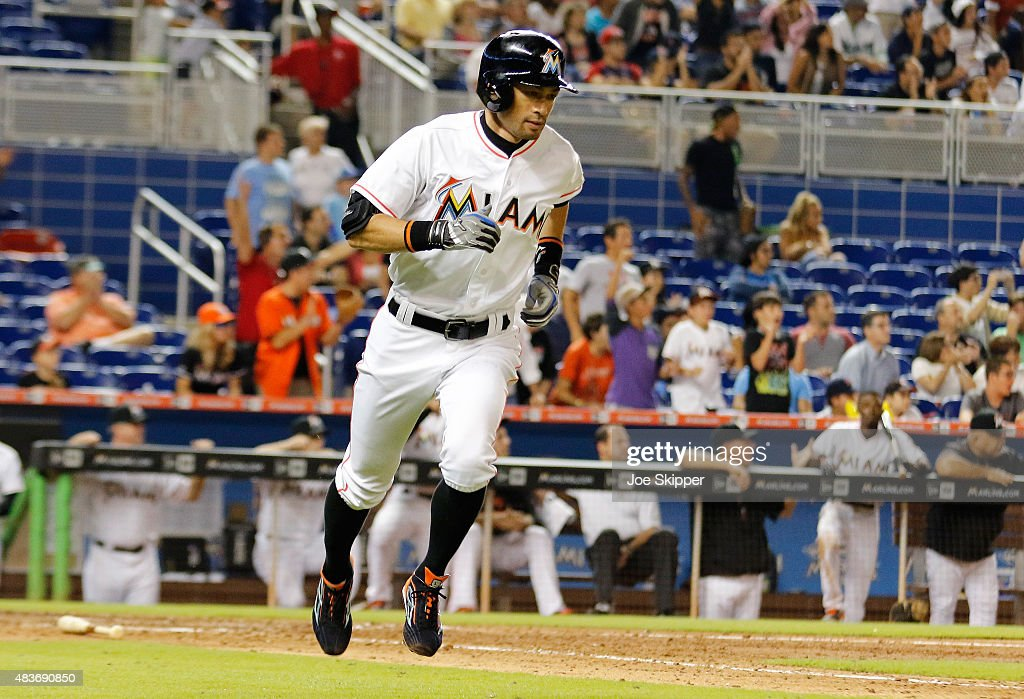Ichiro Suzuki #51 of the Miami Marlins runs to first after hitting a ninth inning single against the Boston Red Sox at Marlins Park on August 11, 2015 in Miami, Florida.The Marlins won the game 5-4.
