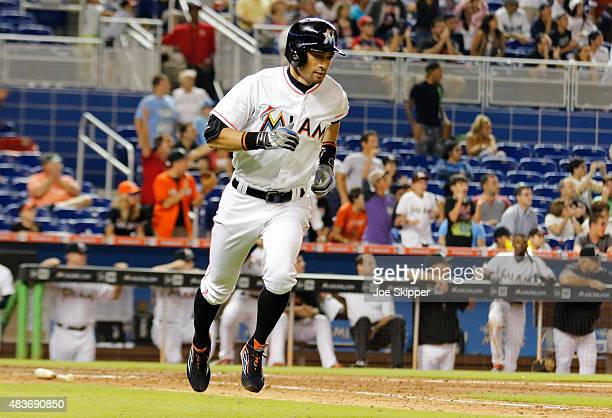 Ichiro Suzuki of the Miami Marlins runs to first after hitting a ninth inning single against the Boston Red Sox at Marlins Park on August 11, 2015 in...