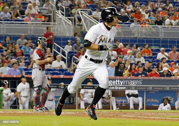 Ichiro Suzuki of the Miami Marlins runs to first base after he hits a an RBI single in the second inning against the Boston Red Sox at Marlins Park...