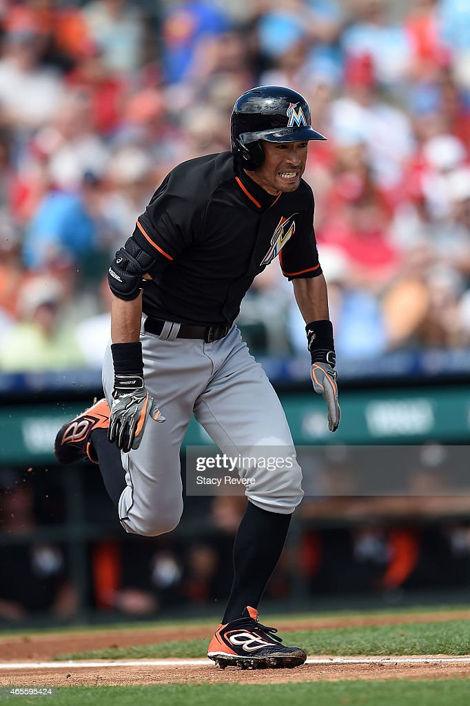 Ichiro Suzuki #51 of the Miami Marlins runs to first base during the second inning of a spring training game against the St. Louis Cardinals at Roger Dean Stadium on March 8, 2015 in Jupiter, Florida.
