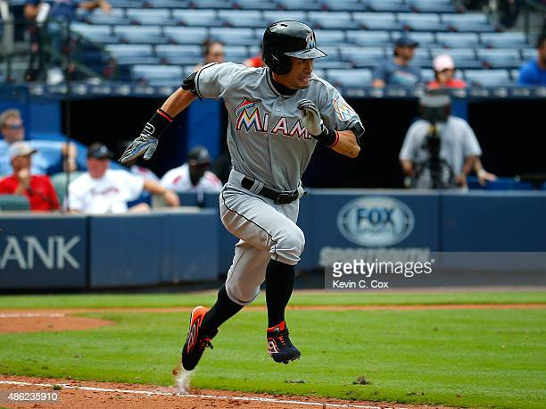 Ichiro Suzuki of the Miami Marlins runs to first base on a single in the eighth inning against the Atlanta Braves at Turner Field on September 2 2015...