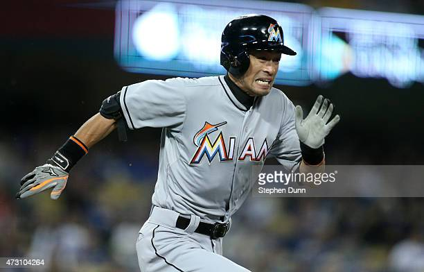 Ichiro Suzuki of the Miami Marlins runs to first but is out on a ground ball for the third out of the top of the seventh inning against the Los...