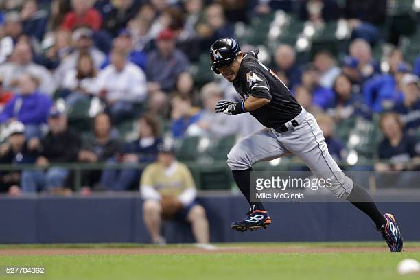 Ichiro Suzuki of the Miami Marlins runs to second base during the game against the Milwaukee Brewers at Miller Park on April 29 2016 in Milwaukee...