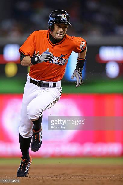Ichiro Suzuki of the Miami Marlins runs to third base during the first inning of the game against the San Diego Padres at Marlins Park on August 2...