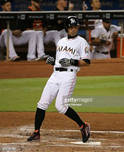 Ichiro Suzuki of the Miami Marlins scores a run during a game against the Chicago Cubs at Marlins Park on June 3 2015 in Miami Florida