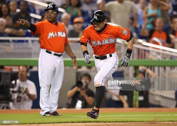 Ichiro Suzuki of the Miami Marlins scores a run during the seventh inning of the game against the Cincinnati Reds at Marlins Park on July 12 2015 in...