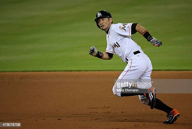 Ichiro Suzuki of the Miami Marlins scores on a 3RBI inside the park home run by Dee Gordon during a game against the San Francisco Giants at Marlins...