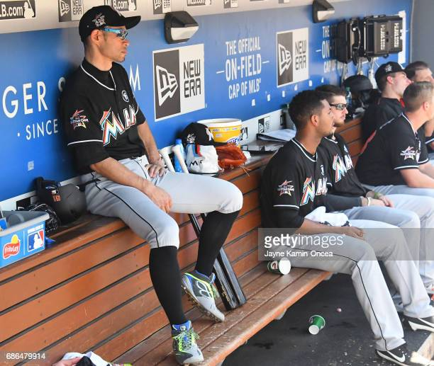 Ichiro Suzuki of the Miami Marlins sits in the dugout after striking out as a pinch hitter in the sixth inning against the Los Angeles Dodgers at...