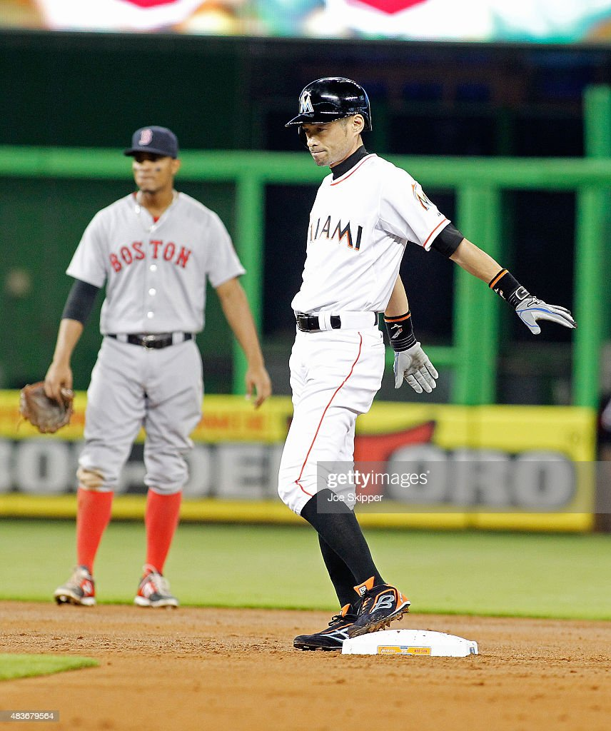 Ichiro Suzuki #51 of the Miami Marlins stands at second after he walked in the second inning at Marlins Park on August 11, 2015 in Miami, Florida. Suzuki advanced to second on a single by teammate Adeiny Hechavarria. Shortstop Xander Bogaerts #2 of the Boston Red Sox stands at left.