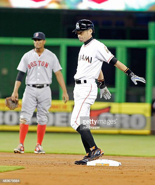 Ichiro Suzuki of the Miami Marlins stands at second after he walked in the second inning at Marlins Park on August 11 2015 in Miami Florida Suzuki...