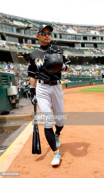 Ichiro Suzuki of the Miami Marlins stands at the dugout prior to the game against the Oakland Athletics at the Oakland Alameda Coliseum on May 24,...