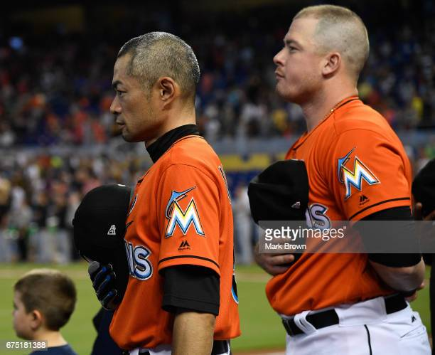 Ichiro Suzuki of the Miami Marlins stands for both the Japanese and American National Anthems before the game between the Miami Marlins and the...