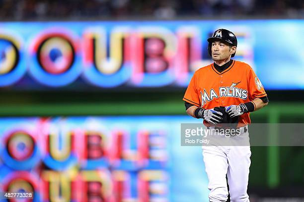 Ichiro Suzuki of the Miami Marlins stands on second base after hitting a double during the first inning of the game against the San Diego Padres at...