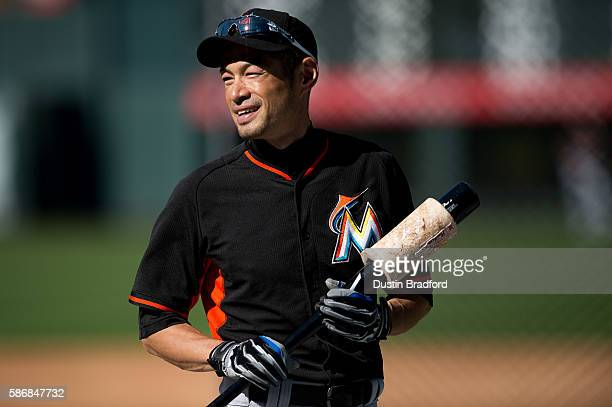 Ichiro Suzuki of the Miami Marlins stands on the field and warms up during batting practice before a game against the Colorado Rockies at Coors Field...