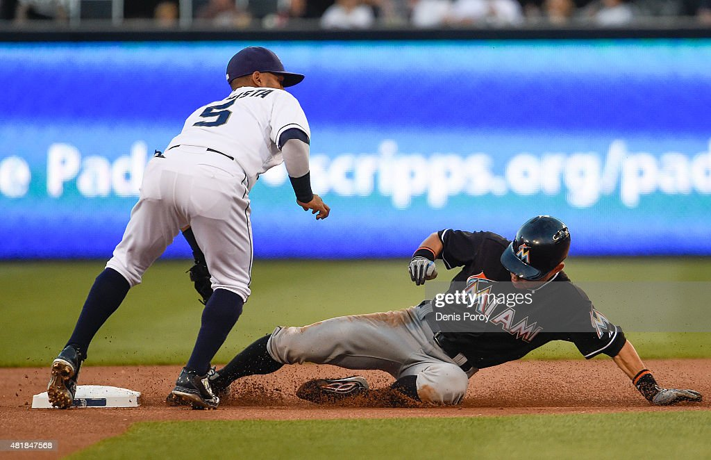 Ichiro Suzuki #51 of the Miami Marlins steals second base ahead of the tag of Alexi Amarista #5 of the San Diego Padres during the first inning of a baseball game at Petco Park July 24, 2015 in San Diego, California.