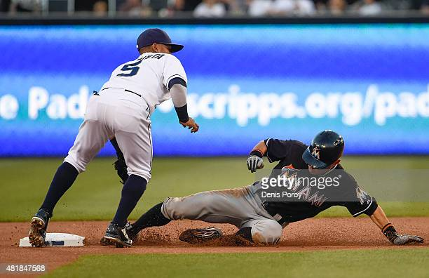 Ichiro Suzuki of the Miami Marlins steals second base ahead of the tag of Alexi Amarista of the San Diego Padres during the first inning of a...