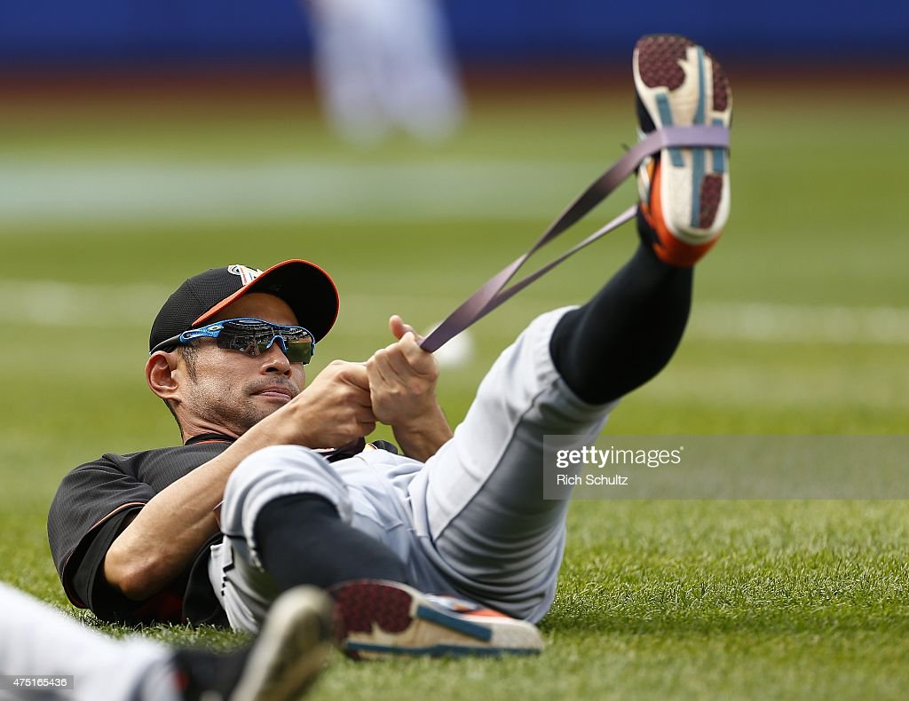 Ichiro Suzuki #51 of the Miami Marlins stretches before a game against the New York Mets on May 29, 2015 at Citi Field in the Flushing neighborhood of the Queens borough of New York City.