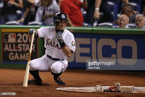Ichiro Suzuki of the Miami Marlins stretches before an at bat during the seventh inning of the game against the Cincinnati Reds at Marlins Park on...