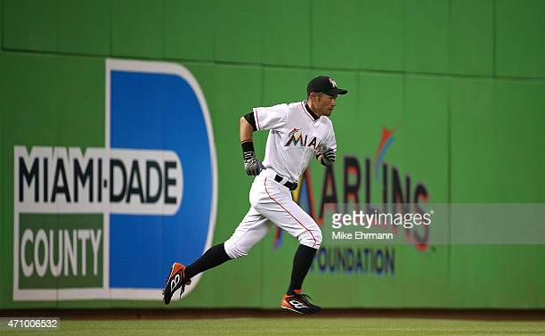 Ichiro Suzuki of the Miami Marlins stretches during a game against the Washington Nationals at Marlins Park on April 24 2015 in Miami Florida