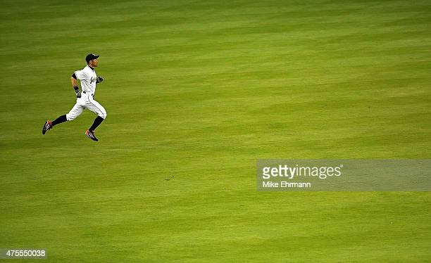 Ichiro Suzuki of the Miami Marlins stretches during a game against the Chicago Cubs at Marlins Park on June 1 2015 in Miami Florida