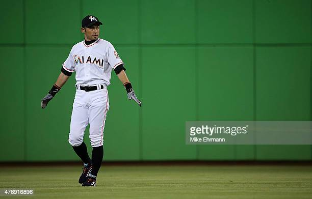 Ichiro Suzuki of the Miami Marlins stretches during a game against the Colorado Rockies at Marlins Park on June 12 2015 in Miami Florida
