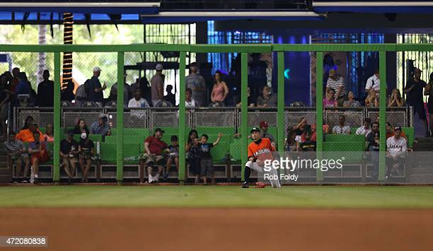 Ichiro Suzuki of the Miami Marlins stretches during the sixth inning of the game against the Philadelphia Phillies at Marlins Park on May 3 2015 in...
