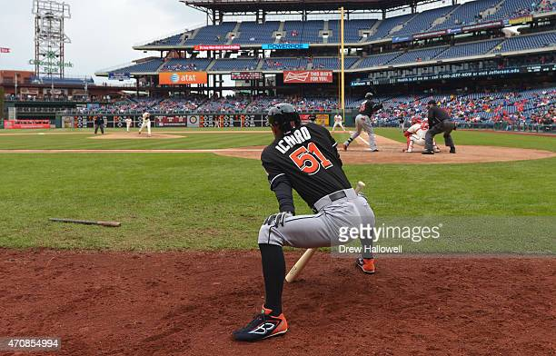 Ichiro Suzuki of the Miami Marlins stretches on deck in the fifth inning against the Philadelphia Phillies at Citizens Bank Park on April 23, 2015 in...