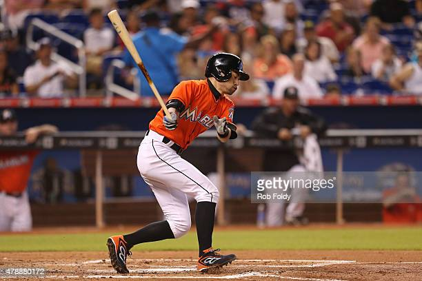 Ichiro Suzuki of the Miami Marlins strikes out swinging during the third inning of the game against the Los Angeles Dodgers at Marlins Park on June...