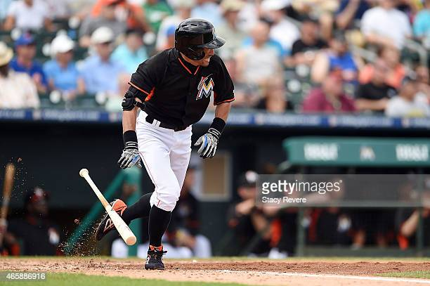 Ichiro Suzuki of the Miami Marlins swings at a pitch during the second inning of a spring training game against the New York Mets at Roger Dean...