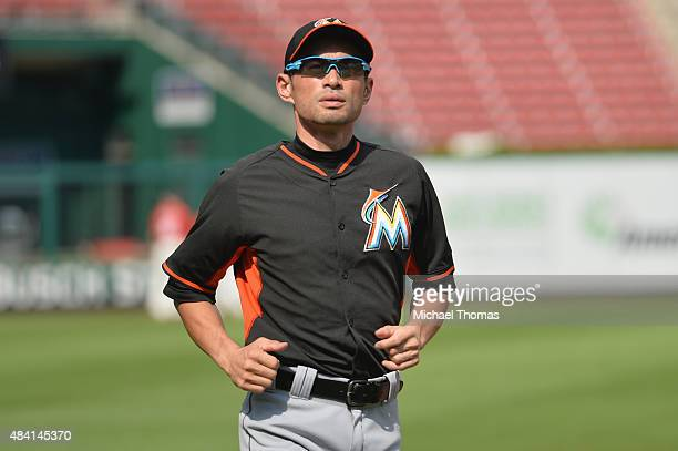Ichiro Suzuki of the Miami Marlins takes the field for batting practice prior to a game against the St Louis Cardinals at Busch Stadium on August 15...