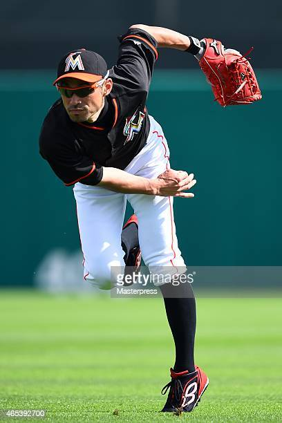 Ichiro Suzuki of the Miami Marlins throws in the practice prior to the spring training game against the St Louis Cardinals at Roger Dean Stadium on...