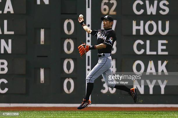 Ichiro Suzuki of the Miami Marlins throws towards home during the fifth inning at Fenway Park on July 7 2015 in Boston Massachusetts