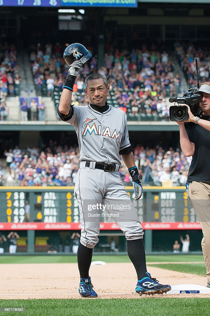 Ichiro Suzuki #51 of the Miami Marlins tips his hat to the crowd after hitting a seventh inning triple against the Colorado Rockies for the 3,000th hit of his major league career during a game at Coors Field on August 7, 2016 in Denver, Colorado.