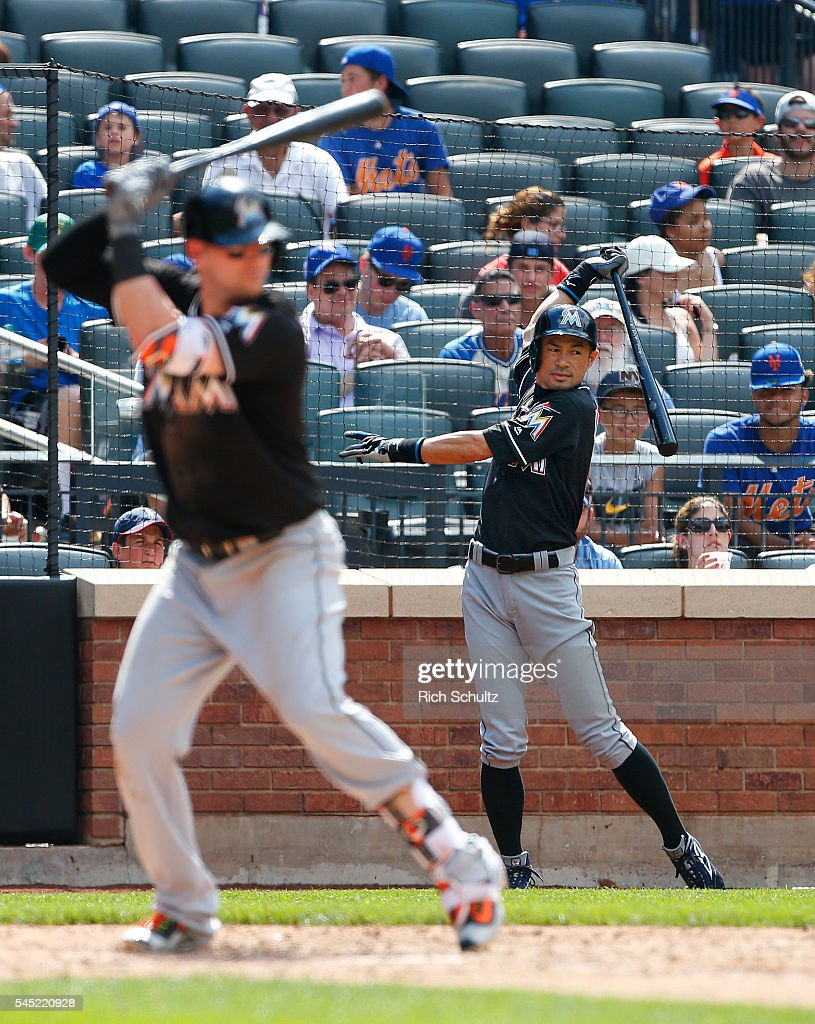 Ichiro Suzuki #51 of the Miami Marlins waits on deck as Chris Johnson #12 bats in the ninth inning against the New York Mets at Citi Field on July 6, 2016 in the Flushing neighborhood of the Queens borough of New York City. The Mets defeated the Marlins 4-2.